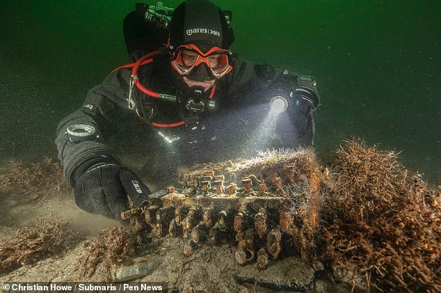 An Enigma machine — the German encryption device used by Nazi forces to send secret message during World War II — has been recovered from the Baltic Sea, pictured
